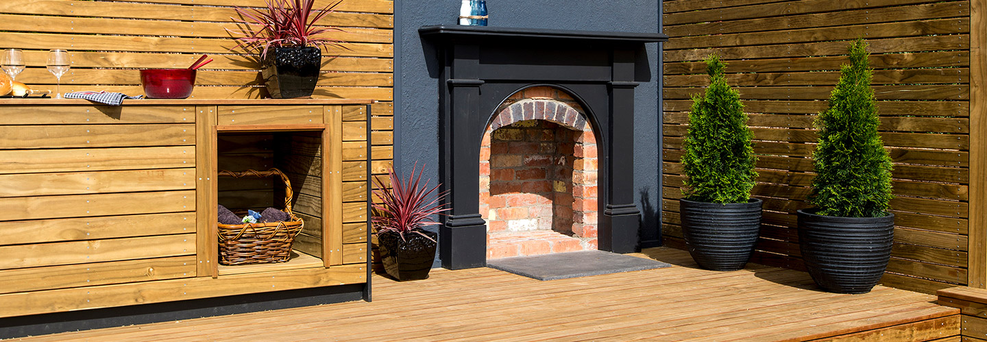 outdoor living area with timber deck and fireplace